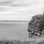 Cliffs of Moher With Boat, Clare, Ireland | infrared black and white photography by Jacqueline LaRocca